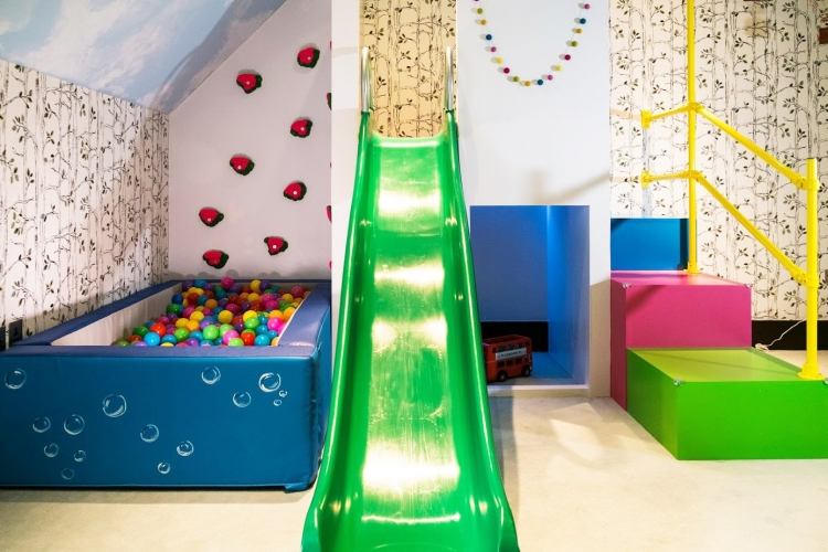 Childrens indoor climbing frame design with slide and ball pit_lego themed playroom_multicoloured playroom_MK Kids Interiors_Brian Yates_Millionaires Playroom