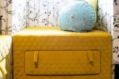 Childrens-reading-Nook_mustard-upholstered-storage-ottoman_pull-out-drawer-ottoman_round-kids-cushion_MK-kids-interiors_childrens-bedroom-design-ideas