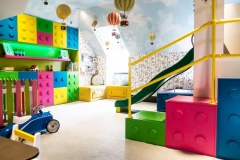 Lego-themed-playroom_Londons-Colourful-PLayroom_Angled-walls-and-sloping-ceiling-kids-room-design_MK-Kids-Interiors_pink-green-blue-yellow-and-white-kids-playroom_playroom-designer