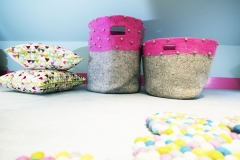 MK Kids Interiors storage baskets_felt storage bags_nursery storage_playroom storage_pink and grey storage baskets_custom harlequin cushions