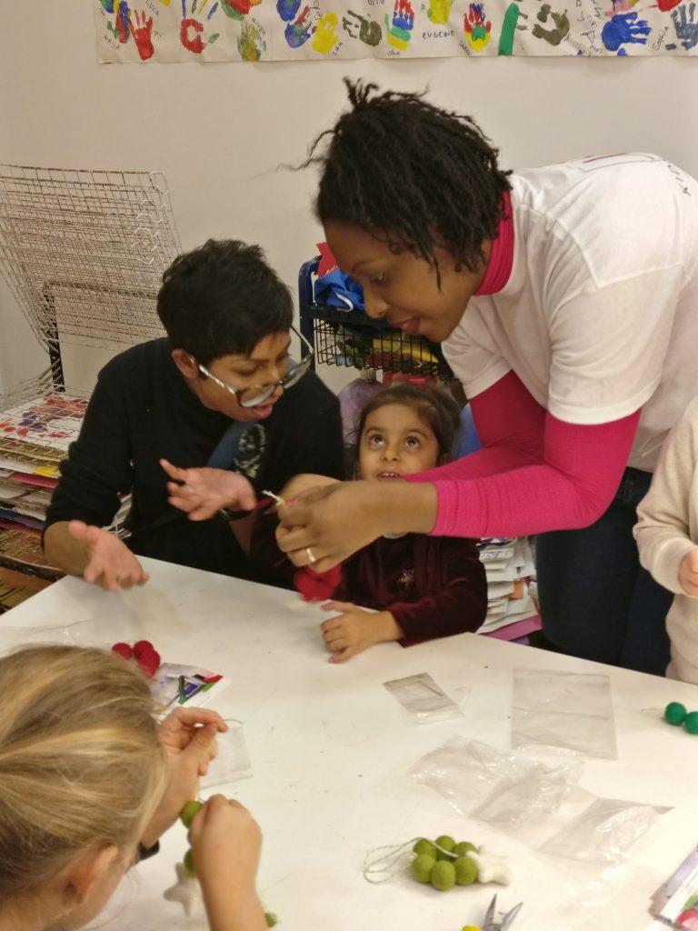 MK Kids Interiors teaching children how to make felt ball garlands_at Purple Dragon PLay-childrens interior designer