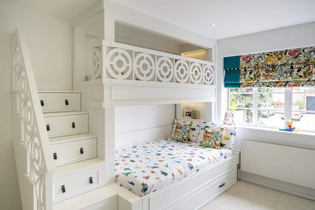 All white kids bedroom- Bespoke kids bed with step drawers-Childrens bedroom- multicoloured roman blinds-saudi arabia-kids interior designer-MK Kids Interiors