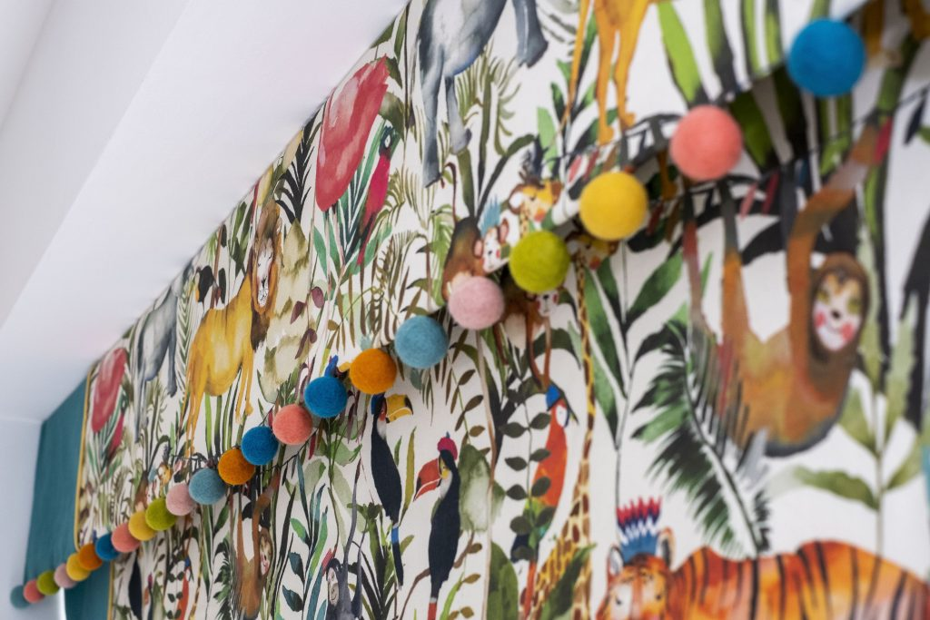 Jungle themed roman blinds with a pom-pom trim- MK Kids Interiors- London childrens interior designer
