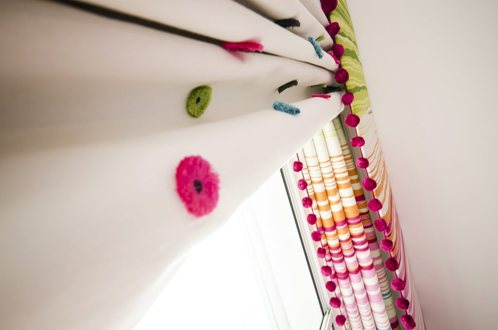 Kids window treatment- multicoloured roman blinds and curtains