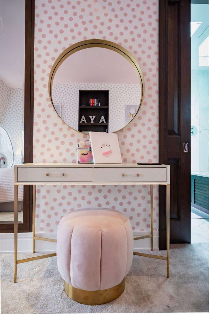 Girls bedroom dressing table and round brass mirror